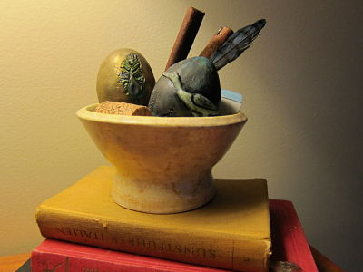 decorative eggs in pottery bowl