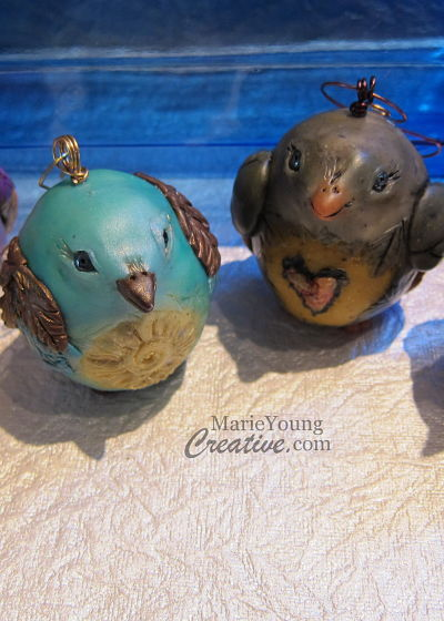 two handcrafted bird ornaments