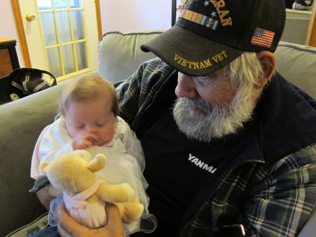 Dad and grand baby # 3, my niece Chloe.