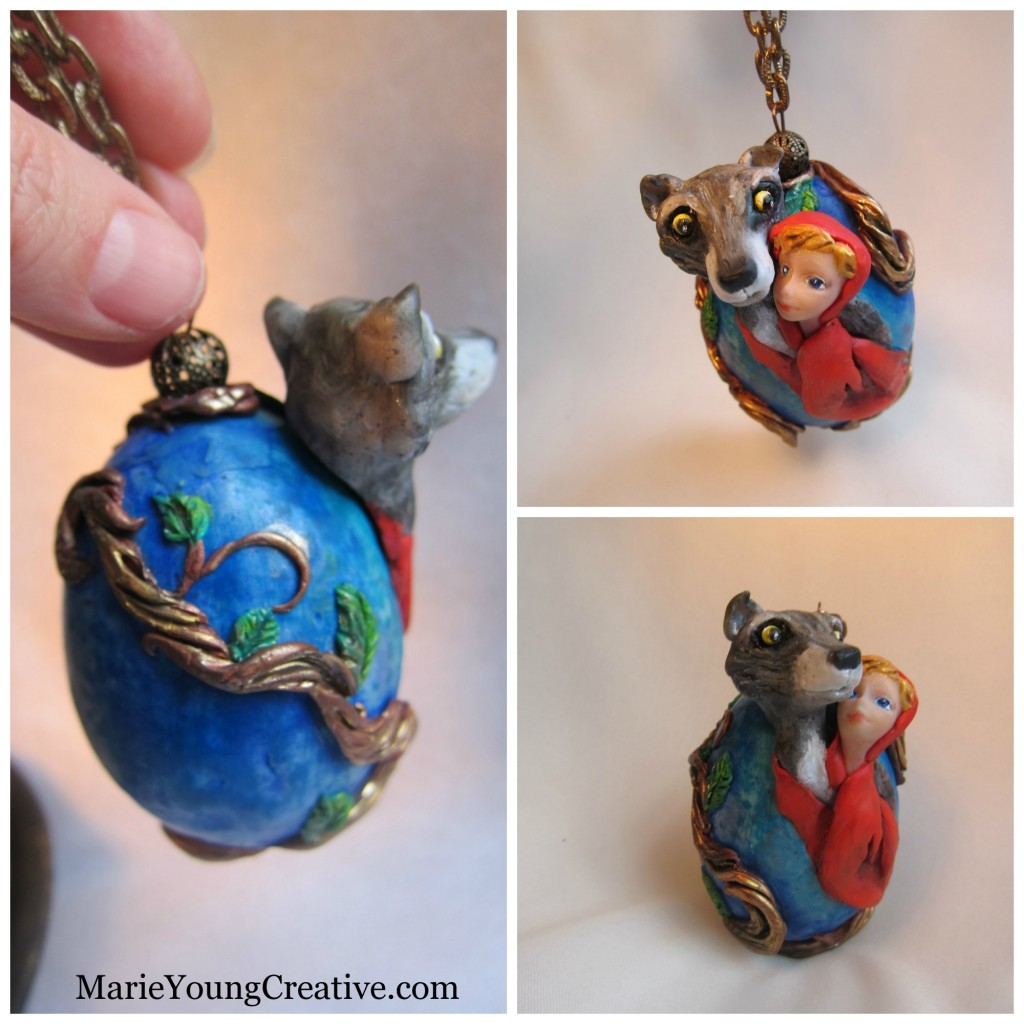 Red Riding Hood embraces her Wolf. Polymer clay covered duck egg.